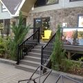 Deck and stairs with black aluminum railing, pickets and glass (built with Trex Decking)