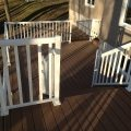 Trex Clip System Decking with wide baluster white railing and glass