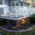Trex decking and skirting with Regal wide picket railing