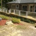 Pressure-treated deck and skirting with Regal glass railing with picket