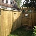 Custom gate with pergola top, fence with lattice insert