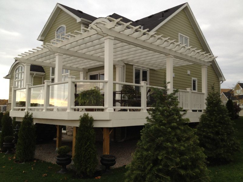Large deck with pergola custom colour match to composite Trex railing with glass and baluster