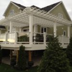 Large-deck-with-pergola-custom-colour-match-to-composite-Trex-railing-with-glass-and-baluster